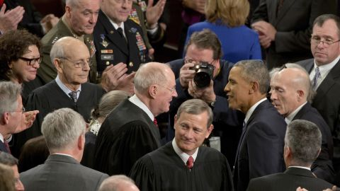 President Obama greets Kennedy and other Supreme Court justices before his final State of the Union address in January 2016.
