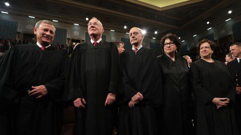 Kennedy, second from left, joins other Supreme Court justices in February 2017 during President Donald Trump's first address to a joint session of Congress.