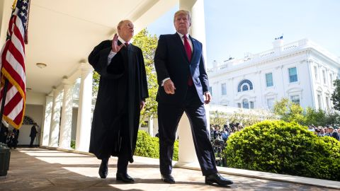 Kennedy and Trump walk together after Gorsuch's swearing-in ceremony.