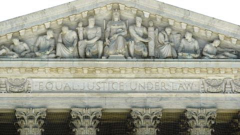 """WASHINGTON - JUNE 29:  """"Equal Justice Under Law"""" is carved into the facade of the United States Supreme Court building June 29, 2009 in Washington, DC."""