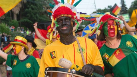 People in blackface wear Cameroon national team jerseys and carry bananas while marching in a government-backed parade in Sochi, Russia on May 27. The city will host one of Cameroon's matches at the Confederations Cup soccer tournament