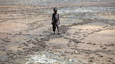 A boy from the remote Turkana tribe in Northern Kenya walks across a dried up river near Lodwar, Kenya. Millions of people across Africa are facing a critical shortage of water and food, a situation made worse by climate change.
