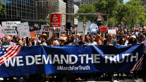 """Demonstrators march as they take part in an anti-Trump """"March for Truth"""" rally on June 3, 2017 in New York City."""