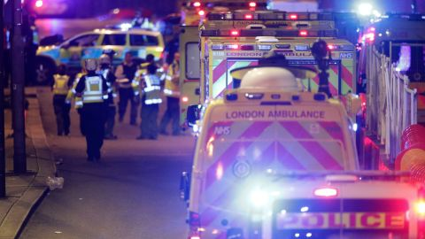 """Emergency personnel on London Bridge after an incident in central London, Saturday, June 3, 2017. British police said they were dealing with """"incidents"""" on London Bridge and nearby Borough Market in the heart of the British capital Saturday, as witnesses reported a vehicle veering off the road and hitting several pedestrians. (Dominic Lipinski/PA via AP)"""
