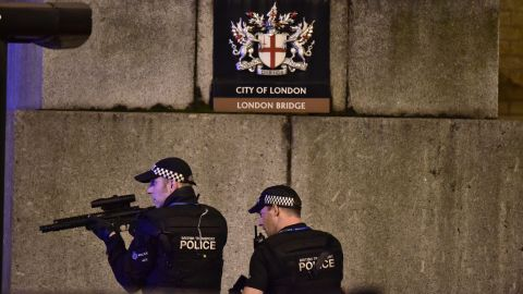 """Armed police patrol near London Bridge on Saturday, June 3. Mayor Sadiq Khan said it was a """"deliberate and cowardly attack"""" on Londoners enjoying Saturday night out."""