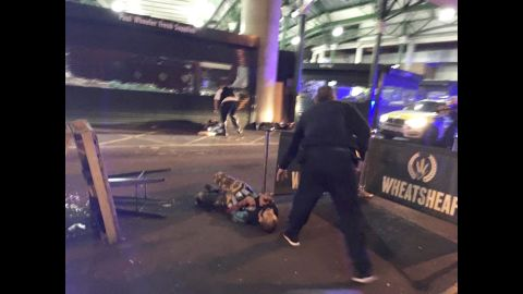 """This image, from London's Borough Market, shows two of the attackers after they were shot by London police. The attackers drove a white van into pedestrians on London Bridge, leaving bodies lying in the roadway, a witness to the incident <a href=""""http://us.cnn.com/2017/06/03/europe/london-bridge-incident/index.html"""" target=""""_blank"""">told CNN</a>."""
