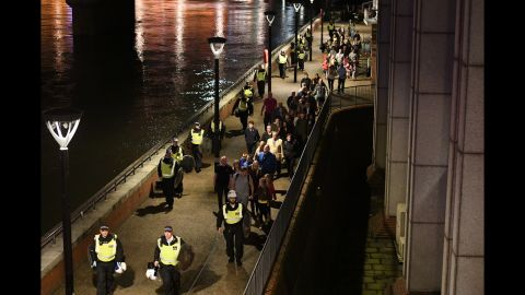 People are lead to safety away from London Bridge.