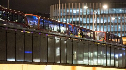 Police carry out a search near empty buses on London Bridge, Saturday, June 3.