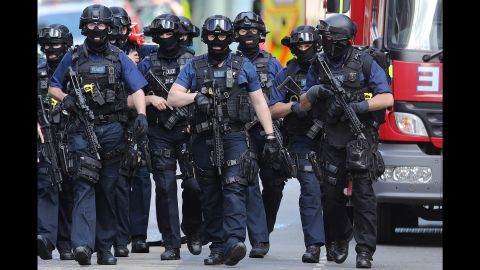 Counterterrorism officers patrol near the scene of the attack on London Bridge. When speaking to the media on Sunday, British Prime Minister Theresa May did not announce any increase in the UK terror threat level.