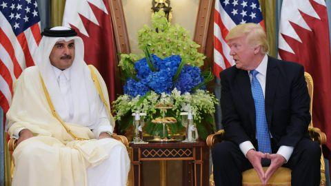 US President Donald Trump (R) and Qatar's Emir Sheikh Tamim Bin Hamad Al-Thani take part in a bilateral meeting at a hotel in Riyadh on May 21, 2017. / AFP PHOTO / MANDEL NGAN        (Photo credit should read MANDEL NGAN/AFP/Getty Images)
