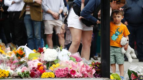 A woman and child lay flowers near London Bridge on Monday to remember the victims of the attack.