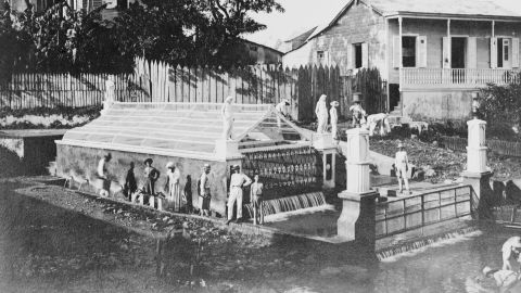 People fill pails with water at the Christopher Columbus Fountain in Aguadilla, Puerto Rico, in 1920. Here, Columbus is said to have stepped on the shore and taken his first American drink.