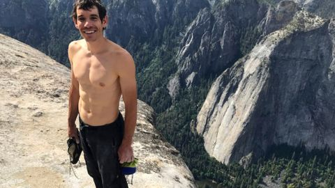 """This Saturday, June 3, 2017, photo provided by National Geographic shows Alex Honnold atop El Capitan in Yosemite National Park, Calif., after he became the first person to climb alone to the top of the massive granite wall without ropes or safety gear. National Geographic recorded Honnold's historic ascent, saying the 31-year-old completed the """"free solo"""" climb Saturday in nearly four hours. The event was documented for an upcoming National Geographic feature film and magazine story. (Jimmy Chin/National Geographic via AP)"""