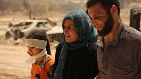 Salim siblings: From left to right, Mariam, Ina'am and Shamil Salim, got out of their house as it collapsed, killing a sister and burying a brother and both parents under the rubble. Iraqi security forces cannot get to the house because it is still under ISIS control.
