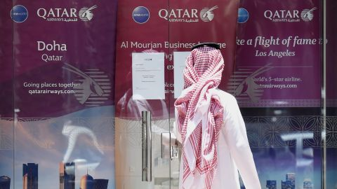 A picture taken on June 5, 2017 shows a man standing outside the Qatar Airways branch in the Saudi capital Riyadh, after it had suspended all flights to Saudi Arabia following a severing of relations between major gulf states and gas-rich Qatar. Arab nations including Saudi Arabia and Egypt cut ties with Qatar accusing it of supporting extremism, in the biggest diplomatic crisis to hit the region in years. / AFP PHOTO / FAYEZ NURELDINE        (Photo credit should read FAYEZ NURELDINE/AFP/Getty Images)