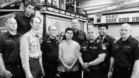 Alcides Moreno, center, with the New York Fire Department workers who helped save him.