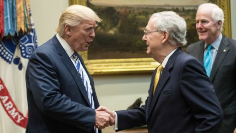 US President Donald Trump shakes hands with Senate Majority Leader Mitch McConnell as he meets with Republican congressional leaders in the Roosevelt Room at the White House in Washington, DC, on June 6, 2017.  (NICHOLAS KAMM/AFP/Getty Images)
