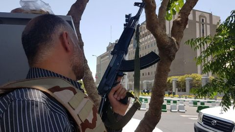 An Iranian security forces officer takes a position Wednesday outside the parliament building in Tehran.