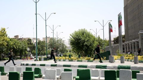 Police on Wednesday storm the parliament building in Tehran.