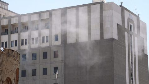 Smoke rises Wednesday from the parliament building in Tehran. Attackers took hostages and detonated at least one suicide bomb. All four attackers were killed by security forces, the semi-official Fars news agency reported.