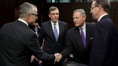 WASHINGTON, DC - JUNE 07:  Senate Intelligence Committee Chairman Richard Burr (R-NC) (2nd R) and ranking member Sen. Mark Warner (D-VA) (2nd L) greet Acting FBI Director Andrew McCabe (L) and Deputy Attorney General Rod Rosenstein before a hearing in the Hart Senate Office Building on Capitol Hill  June 7, 2017 in Washington, DC. The intelligence and security officials testified about re-authorization of Section 702 of the Foreign Intelligence Surveillance Act, which is the law the NSA uses to track emails and phone calls of non-US citizens.  (Photo by Chip Somodevilla/Getty Images)