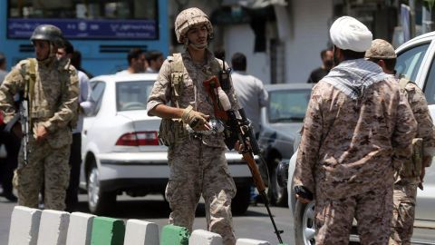 Members of the Iranian Revolutionary Guard secure the area outside the Iranian parliament during an attack on the complex in the capital Tehran on June 7, 2017.Gunmen and suicide bombers carried out coordinated attacks on Iran's parliament and the tomb of revolutionary founder Ruhollah Khomeini on June 7, 2017, state media reported, killing at least three people. / AFP PHOTO / FARS NEWS / Hossein MERSADIHOSSEIN MERSADI/AFP/Getty Images