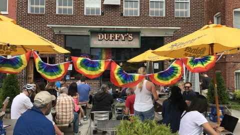 A crowd gathered outside Duffy's Irish Pub in Washington D.C. on Thursday June 8, 2017 for ousted FBI Director James Comey's testimony on the Hill.