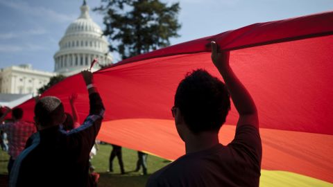 WASHINGTON - OCTOBER 11:  Activists carry a rainbow flag on the West Lawn of the US Capitol Building during a protest October 11, 2009 in Washington, DC.  Activists gathered in DC to push President Barack Obama's administration and the U.S. Congress to live up to promises to the lesbian, gay, bisexual and transgender community to advance civil rights.  (Photo by Brendan Smialowski/Getty Images)