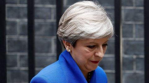 Britain's Prime Minister and leader of the Conservative Party Theresa May leaves 10 Downing Street in central London on June 9, 2017, en route to Buckingham Palace to meet Queen Elizabeth II, the day after a general election in which the Conservatives lost their majority.British Prime Minister Theresa May will on Friday seek to form a new government, resisting pressure to resign after losing her parliamentary majority ahead of crucial Brexit talks. May is set to meet the head of state Queen Elizabeth II and ask for permission to form a new government, according to her Downing Street office. / AFP PHOTO / Odd ANDERSEN        (Photo credit should read ODD ANDERSEN/AFP/Getty Images)