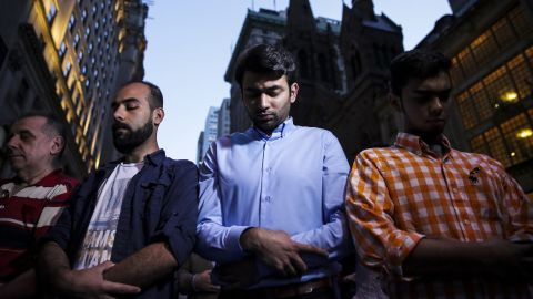 Demonstrators pray during an Iftar outside of Trump Tower on June 1.