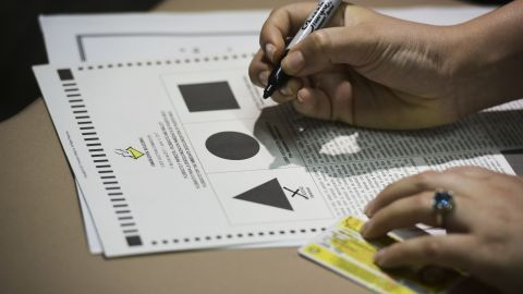 A Puerto Rican voter ticks a ballot during the fifth referendum in San Juan, Puerto Rico.