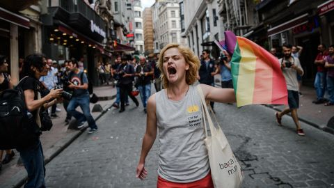 A protester waves a rainbow flag during a rally staged by the LGBT community in Istanbul in 2016.