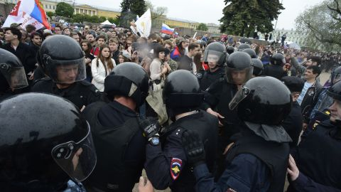 """Russian police officers face demonstrators during an unauthorized opposition rally in centre of Saint Petersburg on June 12, 2017.  Over 200 people were detained on June 12, 2017 by police at opposition protests called by Kremlin critic Alexei Navalny, said a Russian NGO tracking arrests. """"About 121 people were detained in Moscow up to this point. In Saint-Petersburg - 137,"""" OVD-Info group, which operates a detention hotline, wrote on Twitter.  / AFP PHOTO / OLGA MALTSEVA        (Photo credit should read OLGA MALTSEVA/AFP/Getty Images)"""
