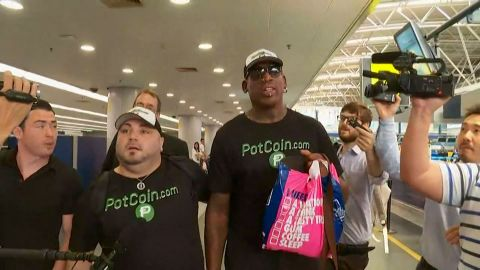 """At the Beijing airport, Rodman told CNN he was hoping to do """"something that's pretty positive"""" before boarding a plane bound for North Korea."""