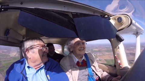 """Mildred """"Milly"""" Reeves, right, flies a Cessna Model 172 with assistance from pilot Pete Lockner, left. (Screengrab of family video/YouTube)"""