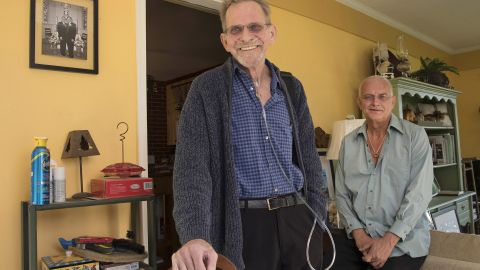 """Bruce Mead-e, left, and his husband, Chuck Mead-e, 60, had a meeting with a pastoral care provider who emphasized """"the bright side of things,"""" Bruce says. """"It helped me feel hopeful."""" (Eileen Blass/for Kaiser Health News)"""
