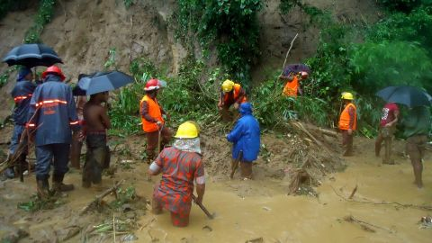 Firefighters search for bodies in Bandarban. Authorities fear the death toll will rise.