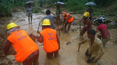 Rescue crews search for bodies Tuesday after a landslide in the Bandarban district.