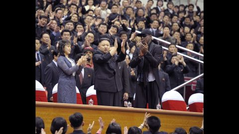 A photo released by the Korean Central News Agency shows Kim and Rodman clapping during a basketball game between the Harlem Globetrotters and players from the North Korean University of Physical Education in February 2013.