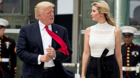 President Donald Trump and Ivanka Trump walk across the tarmac to board Air Force One at Andrews Air Force Base on Tuesday, June 13, 2017.