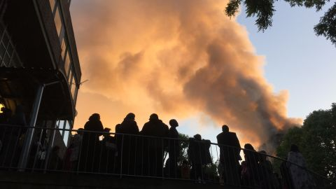 Residents of nearby Whitchurch Road watch smoke streaming from the tower.