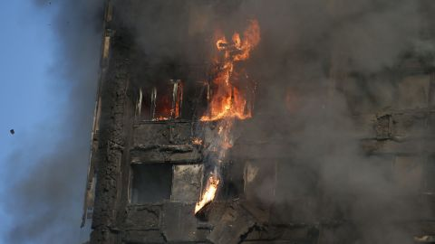 """Fire rips through Grenfell Tower as firefighters attempt to control a huge blaze on June 14, 2017 in west London.  The massive fire ripped through the 27-storey apartment block in west London in the early hours of Wednesday, trapping residents inside as 200 firefighters battled the blaze. Police and fire services attempted to evacuate the concrete block and said """"a number of people are being treated for a range of injuries"""", including at least two for smoke inhalation.   / AFP PHOTO / Daniel LEAL-OLIVAS        (Photo credit should read DANIEL LEAL-OLIVAS/AFP/Getty Images)"""