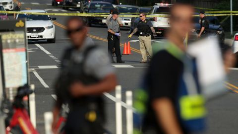 ALEXANDRIA, VA - JUNE 14:  Investigators gather near the scene of an opened fire June 14, 2017 in Alexandria, Virginia. Multiple injuries were reported from the instance.  (Photo by Alex Wong/Getty Images)