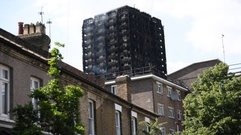 Smoke continues to rise from the 24-story residential Grenfell Tower in west London Wednesday afternoon.