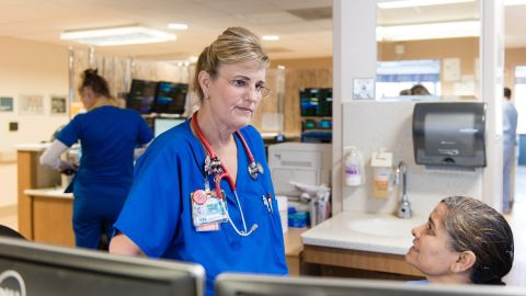 Dawn Nagel, a sepsis nurse, spends her day trying to identify and treat sepsis patients quickly so they don't deteriorate. (Heidi de Marco/KHN)