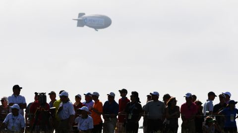 """Early on day one of the 117th US Open spectators and players saw a blimp fall out of the sky near the Erin Hills course in Wisconsin. The pilot was taken to hospital with """"serious burns,"""" according to the Washington County Sheriff's Office."""