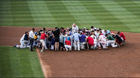 A prayer is held prior to the start of the Congressional Baseball Game at National Park in Washington, DC on June 15, 2017.