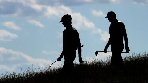 Guess who? Two-time Masters winner Bubba Watson and Sergio Garcia, who triumphed at Augusta in April, walk off the ninth tee Thursday afternoon.