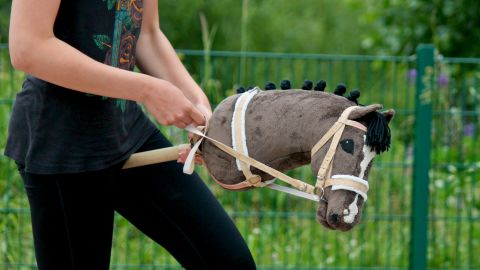"""Hobbyhorsing is the latest equestrian trend sweeping Finland, a """"horse crazy"""" nation."""