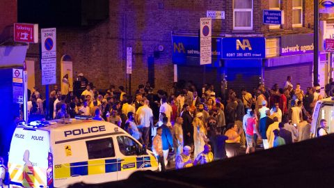 """Resident Cynthia Vanzella said she was in bed when she heard people shouting. She went to the window and saw """"loads of people gathering"""" in a corner across the road."""